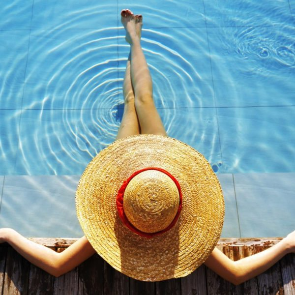 best-travel-wallpaper-Woman-in-pool-top-view-hat